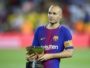FC Barcelona's Andres Iniesta holds the Joan Gamper trophy after a friendly soccer match between FC Barcelona and Chapecoense at the Camp Nou stadium in Barcelona, Spain, Monday, Aug. 7, 2017. FC Barcelona defeated Chapecoense. (AP Photo/Manu Fernandez)