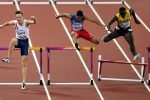 Norway's Karsten Warholm, left, leads Dominican Republic's Juander Santos and Jamaica's Kemar Mowatt during their Men's 400 meters hurdles semifinal during the World Athletics Championships in London Monday, Aug. 7, 2017. (AP Photo/Martin Meissner)