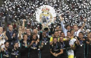 Real Madrid celebrate with the trophy after defeating Manchester United 2-1 during the Super Cup final soccer match at Philip II Arena in Skopje, Tuesday, Aug. 8, 2017. (AP Photo/Boris Grdanoski)